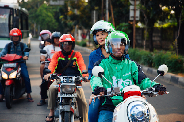 A Go-Jek driver and passenger in Jakarta